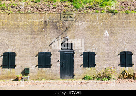 Entrance to barrack on bastion Katten in old fortified town of Naarden, North Holland, Netherlands - Stock Photo