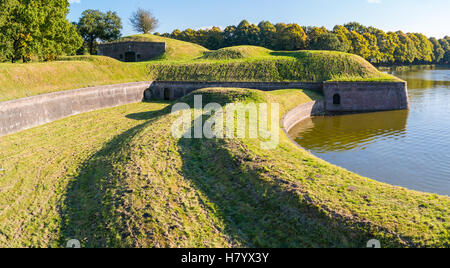 Bastion Promers with barracks and moat of old fortified town of Naarden, North Holland, Netherlands - Stock Photo