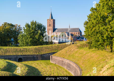 Big Church and rampart with bastion Promers in old fortified town of Naarden, North Holland, Netherlands - Stock Photo