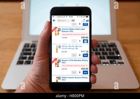 Using iPhone smartphone to display Tesco Groceries online shopping app - Stock Photo