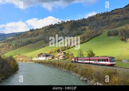 Niedernsill: local train of Pinzgauer Lokalbahn at station Jesdorf-Bergfried, river Salzach, Pinzgau, Salzburg, - Stock Photo