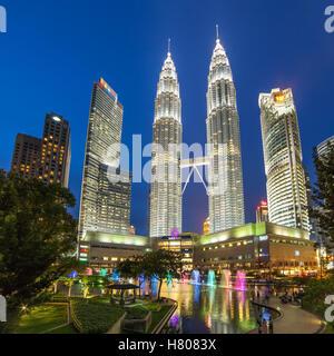 Famouse Petronas Towers at night In Kuala Lumpur, Malaysia. - Stock Photo
