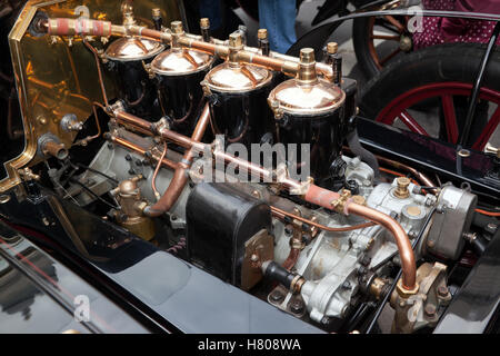 Close-up of the 20HP, 4 cylinder engine on a 1904 De Dion Bouton Tourer, in the Concours d'Elegance, in Regents - Stock Photo