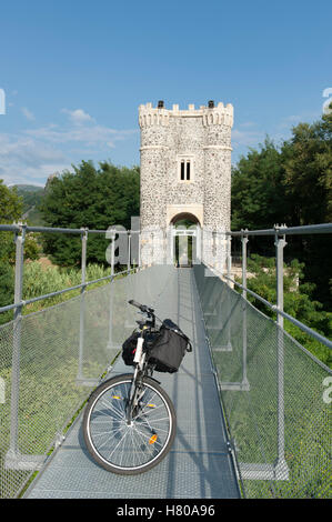 Built in 1858, the Marc Seguin-style wire-cable suspension bridge of Rochemaure today is reserved for pedestrians - Stock Photo