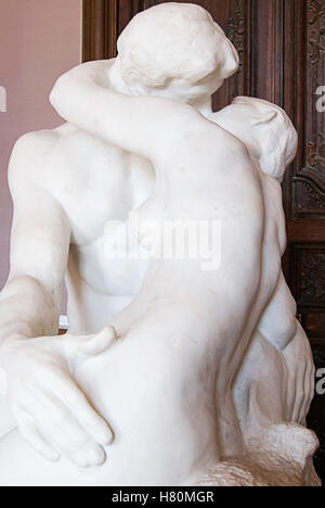 The Kiss by Auguste Rodin at the Rodin Museum in Paris, France. - Stock Photo