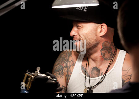 Tattoo artist Ami James attends the tattoo convention Copenhagen Ink 2013. - Stock Photo