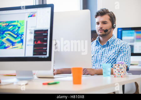 startup business, software developer working on desktop computer - Stock Photo