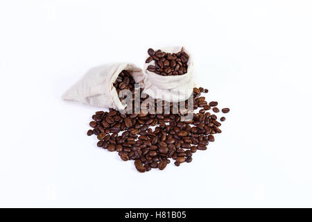 roasted coffee beans in a rag bags, roasted coffee beans on a white background. - Stock Photo