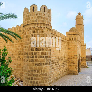 The round corner tower of the defensive fortress of Ribat, located in Medina of Sousse, Tunisia. - Stock Photo