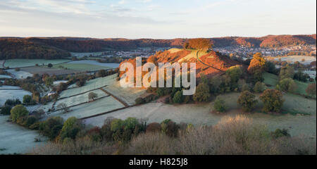 Downham Hill from Uley Bury on a cold frosty autumn morning at sunrise. Cotswolds, Gloucestershire, England. Panoramic - Stock Photo