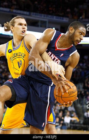 February 25, 2011; Oakland, CA, USA;  Atlanta Hawks center Al Horford (15) grabs a rebound from Golden State Warriors - Stock Photo