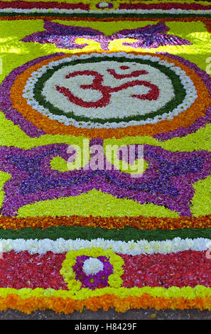 Flower rangoli - decoration made during festivals in India - Stock Photo