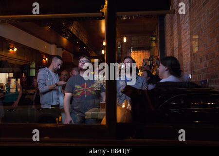 New York, USA. 08th Nov, 2016. Guests watch reporting on the ongoing presidential election in a bar in the borough - Stock Photo
