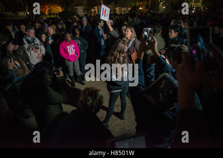 Washington Dc, USA. 09th Nov, 2016. Trump supporter  near The White House humiliated and outnumbered  by Pro Hillary - Stock Photo