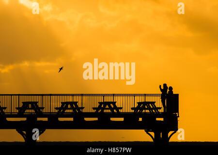 Aberystwyth Wales UK, Thursday  10 November 2016  UK weather : Dramatic sunset over the seaside pier in Aberystwyth - Stock Photo