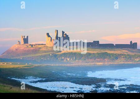 Dunstanburgh Castle on the Northumberland coast, England, UK - Stock Photo