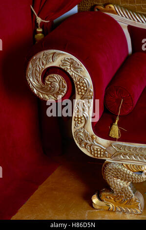 Red velvet textile sofa in the interior room studio - Stock Photo