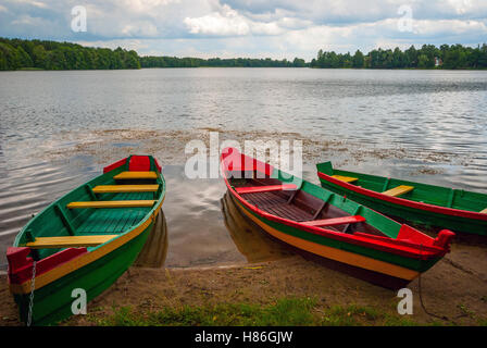 Boats by the lake in lithuanian colors, Trakai, Lithuania - Stock Photo
