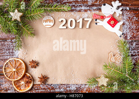 Christmas composition with date of year 2017 on vintage paper in the up of the frame. Inscription, lined with old - Stock Photo