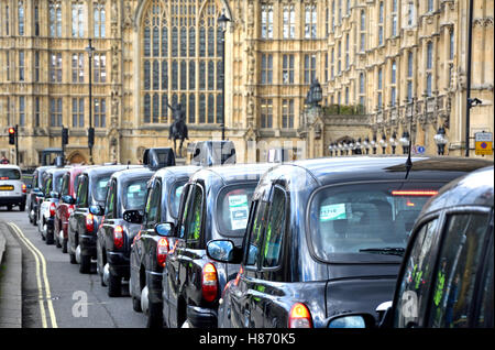 London, England, UK. A long queue of taxis outside Parliament during a protest against Uber, Feb 2016 - Stock Photo