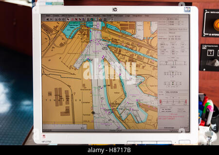 Navigation through Hamburg Harbor by map on a computer of a large container ship - Stock Photo