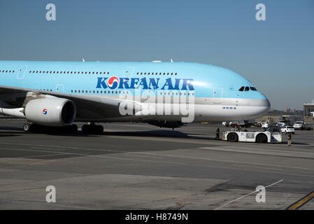 A380 passenger jet at JFK airport New York USA  Korean jet approaching the stand with a tug in attendance - Stock Photo