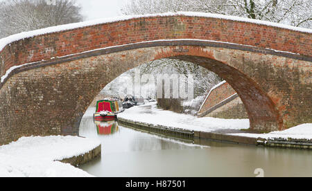 Snow covered Canal towpath in winter; Bridge 62; Rainbow bridge Grand Union Canal - Stock Photo