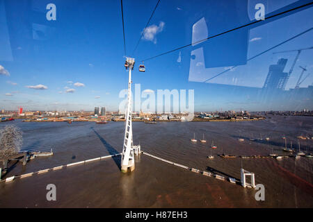 Emirates Air Line gondola cable car across the River Thames from the Greenwich peninsula to the Royal Victoria Dock - Stock Photo