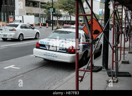 Rear view of a Montreal, Canadian police vehicle seen attending an incident in midtown Montreal, Canada. - Stock Photo