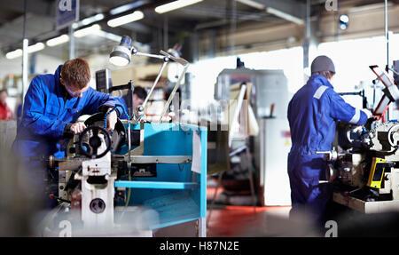 Two young Engineers working on metal Lathes. Northern Powerhouse - Stock Photo