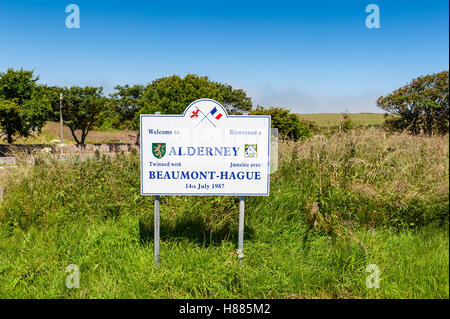 Welcome to Alderney Sign - Stock Photo