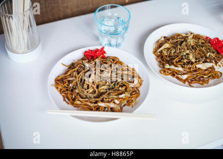 Close up of two plates of Soba noodles, fast food.