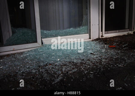... Shattered Glass In The Night Near A Sliding Glass Door   Stock Photo