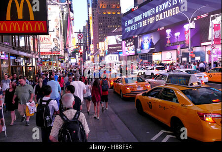 NEW YORK, UNITED STATES. AUGUST 24TH 2016. Tourists in Times Square at evening hours. - Stock Photo