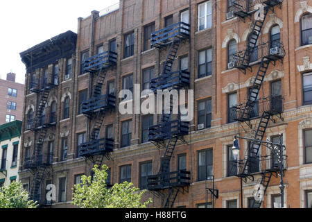New York, United States. August 25th 2016. New York brick buildings with outside fire escape stairs - Stock Photo