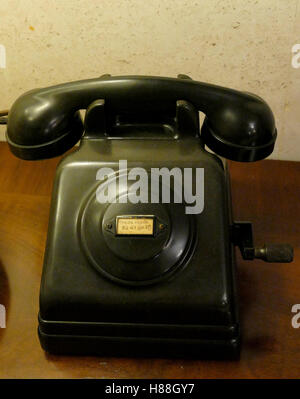 Old telephone with dust and scratches - Stock Photo