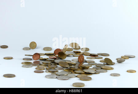 Coins fall into a pile - Stock Photo