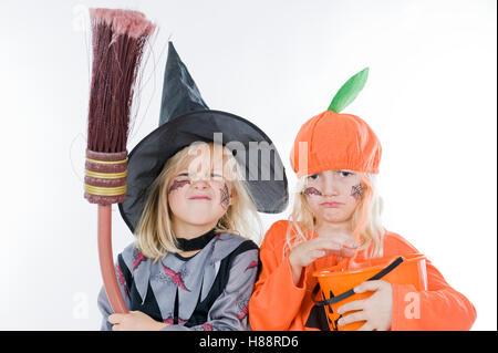 Children wearing Halloween costumes - Stock Photo