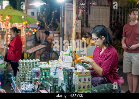 Chiang Mai night market, Thailand. Late evening just ...