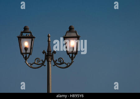 Vintage, old street lamp in classic style, made of cast iron and or metal - Stock Photo