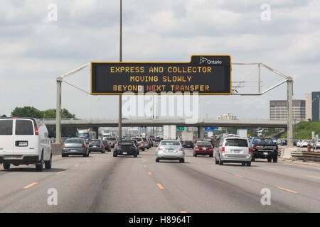 Highway 401 electronic highway sign express and collector lanes information, Toronto, Ontario, Canada - Stock Photo