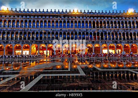 Venice St Mark's Square restaurants on a wet night - Stock Photo
