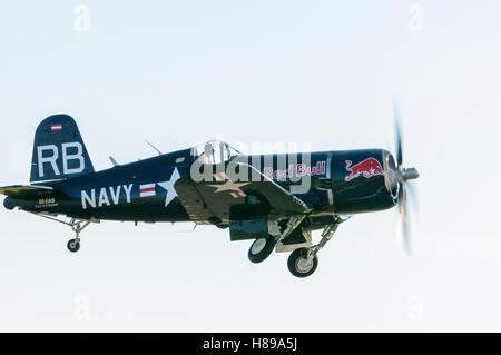 Maribor, Slovenia - April 16, 2016: Red Bull's F4U Corsair taking off at Maribor airport for flight demonstration - Stock Photo