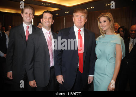 Eric Trump, Donald Trump Jr., Donald Trump and Ivanka Trump at the ribbon cutting ceremony for Trump SoHo New York - Stock Photo