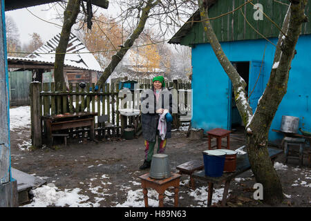 A self-settler who returned after the Chernobyl disaster at her farm in the village Opachici. Chernobyl Exclusion - Stock Photo