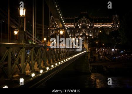 Széchenyi Chain Bridge by night and Four Seasons Hotel Gresham Palace - Stock Photo