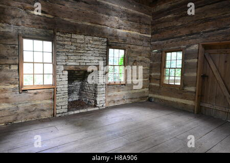 A fireplace in a log wood cabin in Texas. - Stock Photo