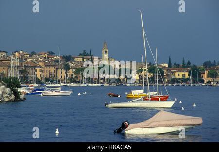 Boats at the buoy off Toscolano Maderno, city view, Lake Garda, Italy, Europe - Stock Photo