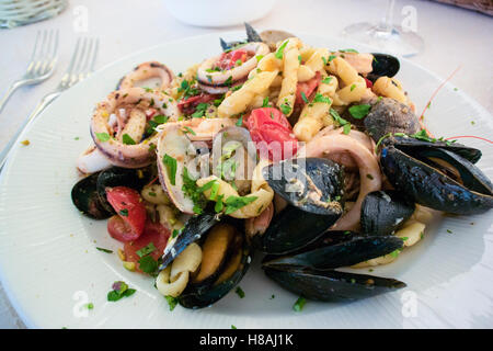 Busiate marinara Trapanese, a typical seafood pasta dish fro the Trapani region of Sicily. - Stock Photo