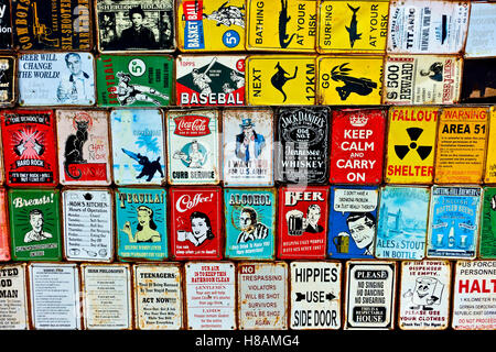 Collectable metal vintage plaques at the Portobello Road market. London, England, UK. Close up - Stock Photo